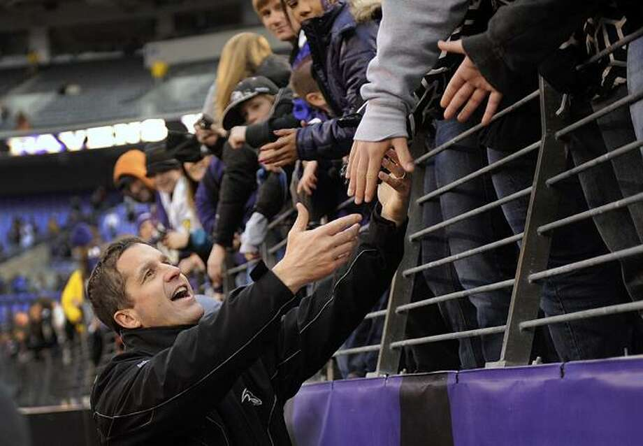 Baltimore Ravens coach John Harbaugh grerts fans after an NFL football game against the Cincinnati Bengals in Baltimore, Sunday, Jan. 2, 2011. The Ravens defeated the Bengals 13-7. (AP Photo/Nick Wass)
