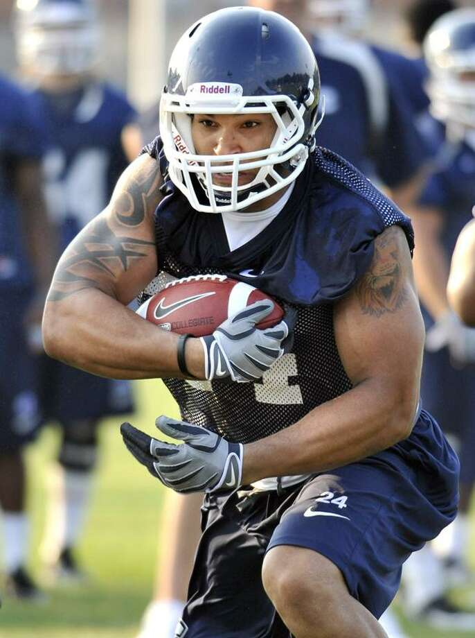 In this Aug. 9, 2010, file photo, Connectcut's D.J. Shoemate runs with the ball during NCAA college football practice at Storrs, Conn. UConn takes on the Michigan Wolverines in Ann Arbor, Mich. today at 3:30 p.m. It's the season opener for both teams. (AP) Photo: AP / FR125654 AP