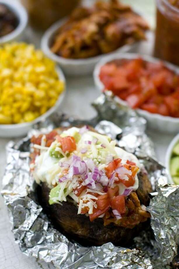 Grilled Baked Potatoes (Matthew Mead/Associated Press photo) Photo: AP / AP2011