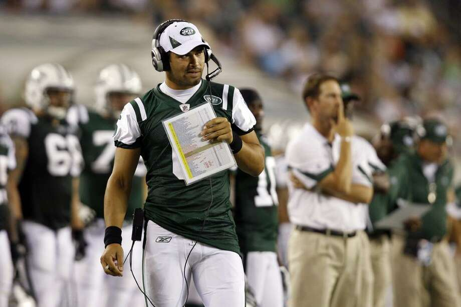 New York Jets quarterback Mark Sanchez watches from sidelines in the first half of an NFL preseason football game against the Philadelphia Eagles, Thursday in Philadelphia. New York won 21-17. (AP Photo/Mel Evans) Photo: AP / AP