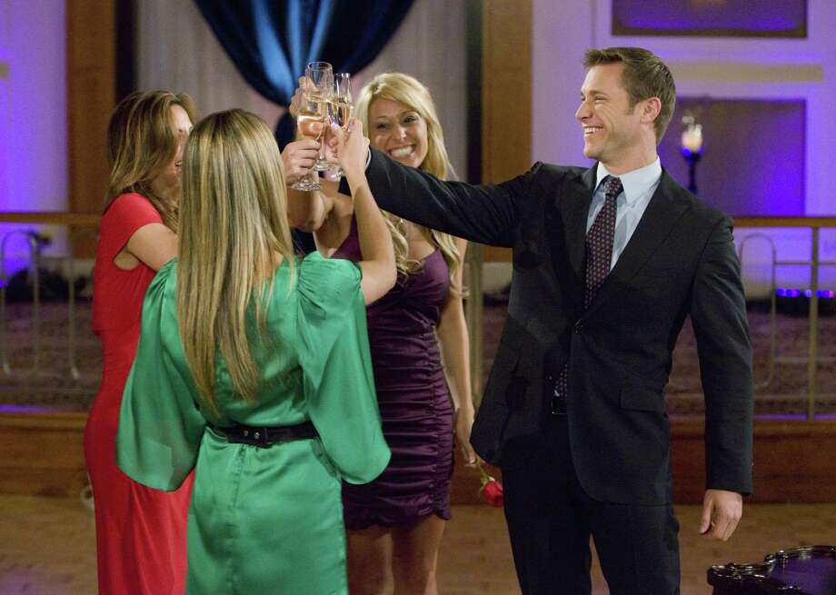 "In this TV publicity image released by ABC, the remaining bachelorettes, clockwise from foreground, Tenley Molzahn, Gia Allemand, and Vienna Girardi, toast with 32-year-old commercial flight instructor Jake Pavelka, shown on ""The Bachelor: On the Wings of Love.""  (AP Photo/ABC, Greg Zabilski) Photo: AP / © 2010 American Broadcasting Companies, Inc. All rights reserved."