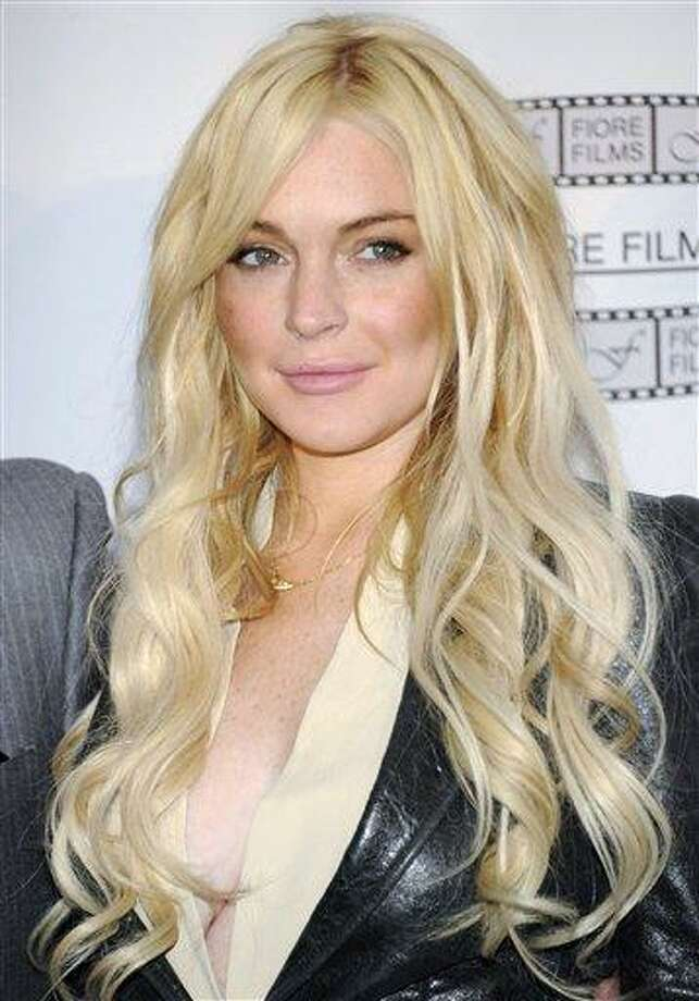 """In this April 12, file photo, actress Lindsay Lohan poses during a news conference for the film """"Gotti: Three Generations"""", based on the life of John Gotti, in New York. Lohan was released from house arrest after serving 35 days for a probation violation. (AP Photo/Evan Agostini, file) Photo: AP / AGOEV"""