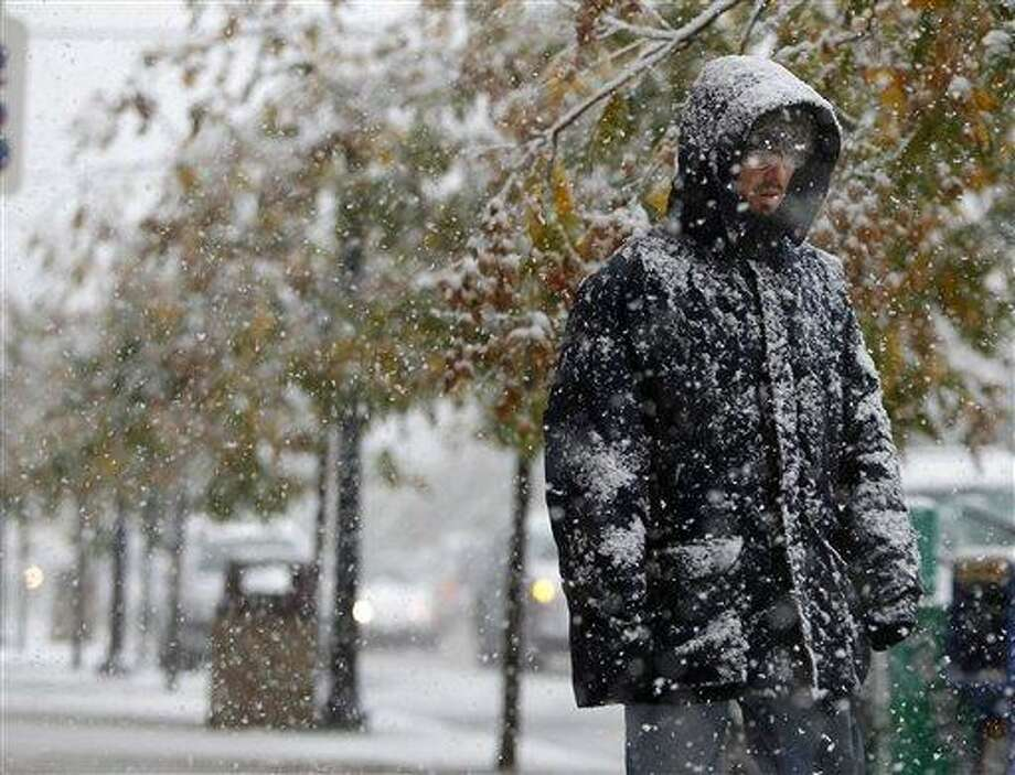 Michael LaBar makes his way along Rt 57 in Washington Borough (Warren Co.), N.J., Saturday Oct. 29, 2011. An unusual October storm dumped wet heavy snow across much of the north east. (AP Photo/Rich Schultz) Photo: AP / FR27227 AP