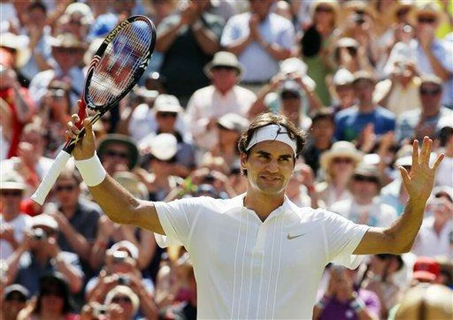 Switzerland's Roger Federer celebrates after his win over Austria's Jurgen Melzer at the All England Lawn Tennis Championships at Wimbledon, Monday. (AP) Photo: AP / AP