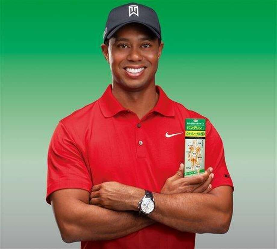 """This image provided by IMG shows Tiger Woods promoting a Japanese pain reliever, his first endorsement since he was caught in a sex scandal toward the end of 2009.  The deal with Kowa Company Ltd. is geared only toward the market in Japan. Woods already has filmed commercials for """"Vantelin Kowa,"""" a heat rub used to relieve muscle and joint pain. (AP Photo/IMG) Photo: AP / IMG"""
