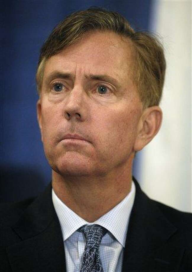 FILE - In this Jan. 20, 2010 file photo, Ned Lamont, listens to speakers at a bipartisan forum in Cromwell, Conn. Lamont, the political upstart who challenged U.S. Sen. Joe Lieberman four years ago, is expected to announce his bid for governor Tuesday, Feb. 16, 2010 at the Old State House in Hartford. (AP Photo/Jessica Hill, File) Photo: AP / AP2010