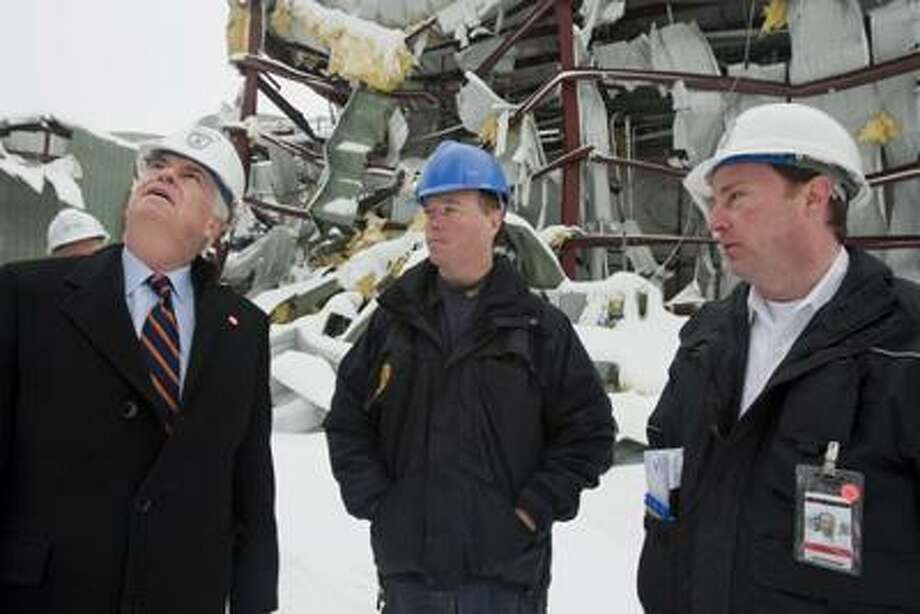 Sen. Christopher Dodd, D-Conn, left, surveys the damage at the Kleen Energy Plant with Jeff Chandler, middle, the DEP emergency response supervisor and Edward Badamo, right, Fire Chief of the South Fire District in Middletown, Conn., on Tuesday, Feb. 16, 2010. Dodd toured the plant, where five people died in an explosion in Middletown, Conn., on Sunday, Feb. 7, 2010. (AP Photo/Thomas Cain) Photo: ASSOCIATED PRESS / AP2010