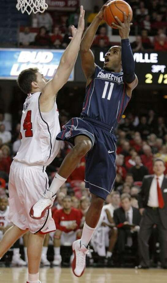 Connecticut's Jerome Dyson shoots over Louisville's Kyle Kuric during the first half of Feb. 1 game. (Associated Press) Photo: ASSOCIATED PRESS / AP2010