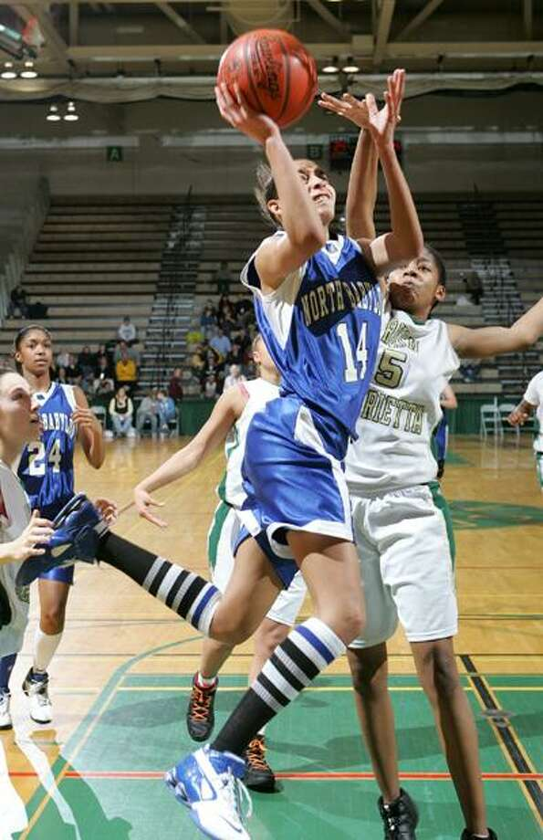 North Babylon's Bria Hartley drives to the basket against Rush-Henrietta during the New York State Athletic Association Class AA girls championship basketball game in Troy, N.Y., Saturday, March 15, 2008. (AP) Photo: ASSOCIATED PRESS / AP