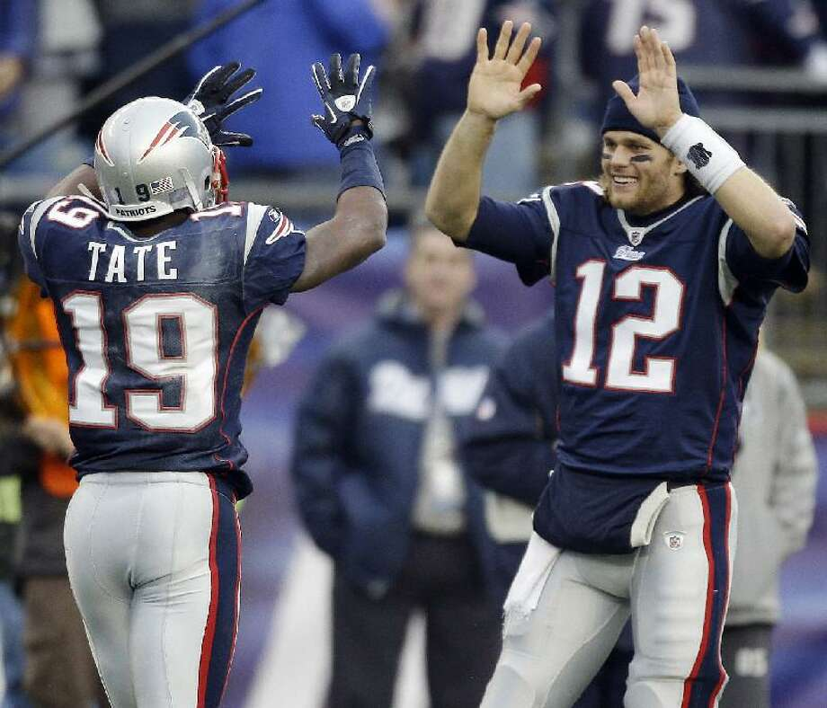 AP New England Patriots wide receiver Brandon Tate (19) is congratulated by starting quarterback Tom Brady (12) while coming off the field during the second half of their game against the Miami Dolphins in Foxboro, Mass., Sunday. Brady was watching from the bench as Tate hauled in a long touchdown pass from backup quarterback Brian Hoyer. The Patriots defeated the Dolphins 38-7.