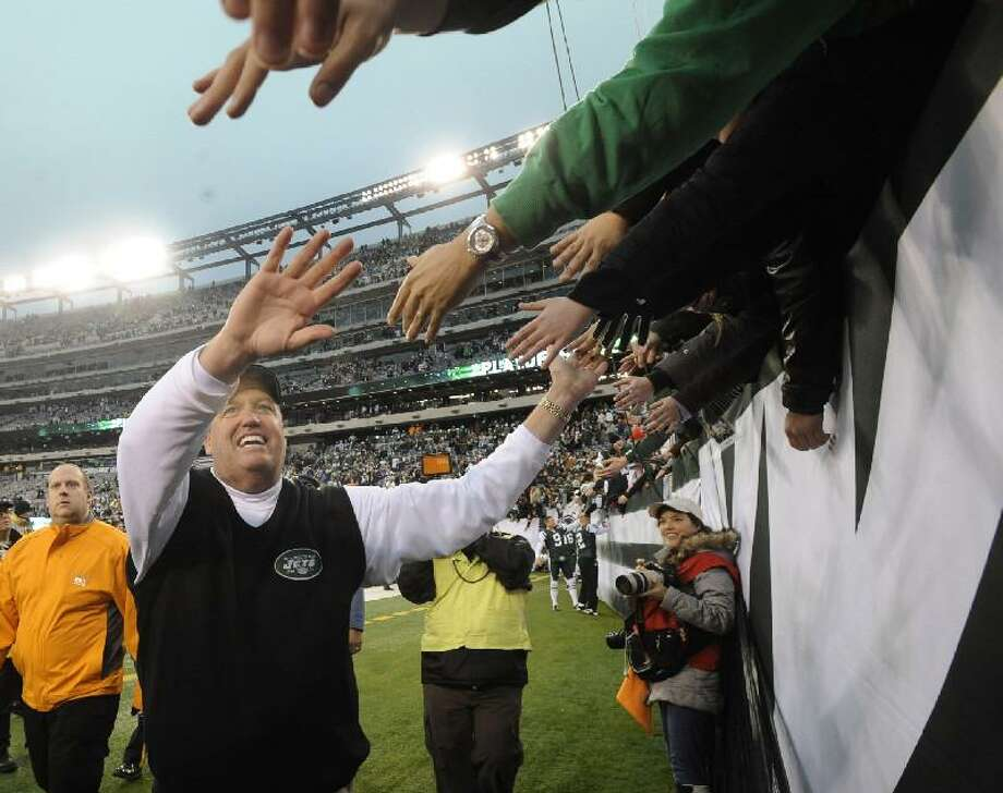AP New York Jets coach Rex Ryan greets fans after the Jets beat the Buffalo Bills 38-7 at New Meadowlands Stadium, Sunday, in East Rutherford, N.J.