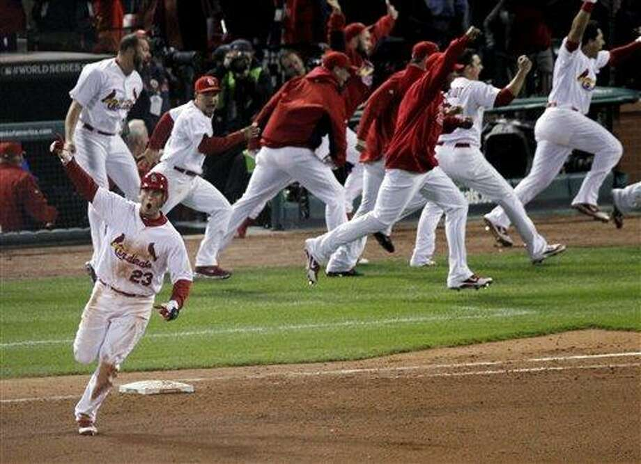 St. Louis Cardinals' David Freese reacts after hitting a solo home run off a pitch by Texas Rangers' Mark Lowe in the 11th inning of Game 6 of baseball's World Series Thursday, Oct. 27, 2011, in St. Louis. The Cardinals won 10-9. (AP Photo/Jeff Roberson) Photo: AP / AP