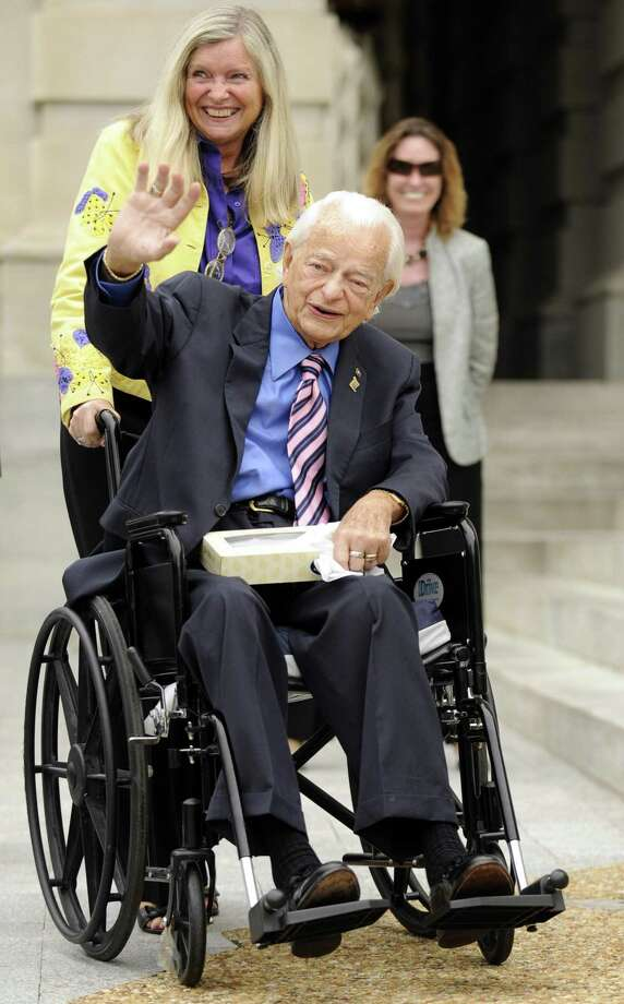 "In this Thursday, Aug. 6, 2009 file photo, Sen. Robert Byrd, <a href=""http://D-W.Va"">D-W.Va</a>., accompanied by long time staffer and scheduler Martha Anne McIntosh, waves as he arrives back on Capitol Hill in Washington. The West Virginia Democrat's office says the 92-year-old lawmaker has been in the hospital since late last week, Sunday, June 27. (AP) Photo: ASSOCIATED PRESS / AP"