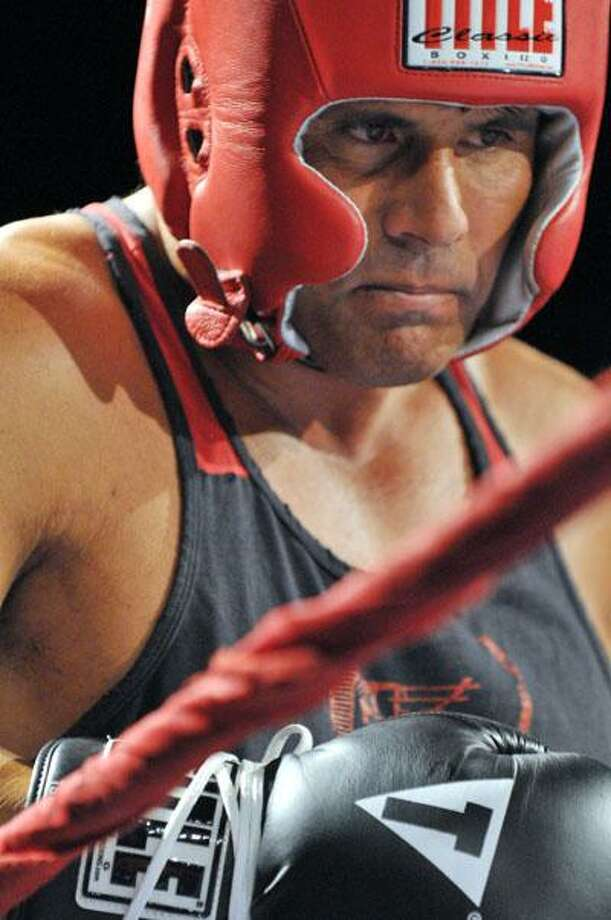 "Jose Canseco waits in between rounds during Saturday night's Main Event boxing match against Middletown native, John Desena as part of the Lions Den ""Fight the Good Fight"" fundraiser for the victims' families of the Kleen Energy power plant explosion. (Ralph Chappell / Special to the Press) / ©Ralph Chappell"