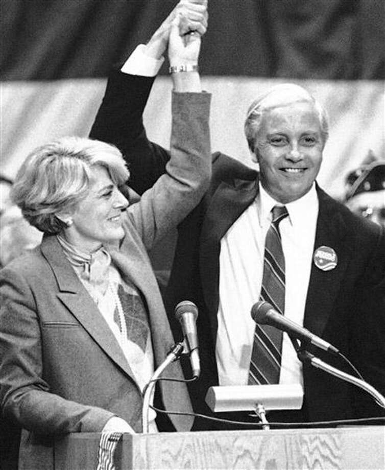 FILE - In this Nov. 14, 1984 file photo, Geraldine Ferraro, Democratic nominee for Vice-President, holds aloft the hand of U.S. Rep. William Ratchford, D-Conn., after she ended a campaign speech in Waterbury, Conn.  Ratchford, who later served in the Clinton administration, died Sunday, Jan. 2, 2011, in Arlington, Va. He was 76. (AP Photo/Bob Child, File) Photo: AP / AP1984