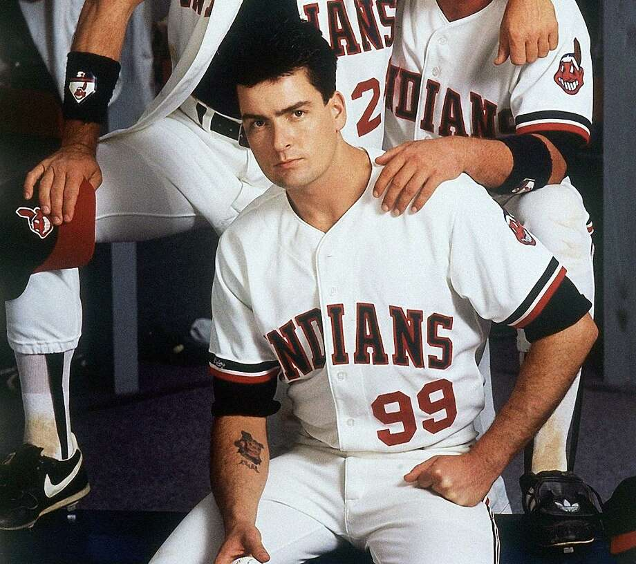 """In this image provided by Paramount Pictures, Tom Berenger, right, plays Cleveland Indians catcher Jake Taylor, Charlie Sheen, below, is the team's pitcher Ackie Vaughn, and Corbin Bemsen, above, plays third baseman Rodger Dom in the Paramount comedy """"Major League"""" in 1989. (AP Photo/Paramount Pictures, Timothy White) NO SALES Photo: ASSOCIATED PRESS / AP1989"""