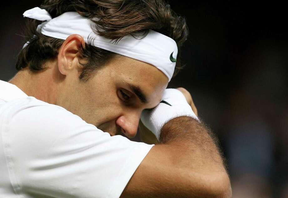 NO UK NEWSPAPER USE. No Zoo Weekly. Editorial use only. No merchandising.Roger Federer looks dejected Wimbledon Tennis Championships, Wimbledon, London, Britain - 29 Jun 2011  (Rex Features via AP Images) Photo: ASSOCIATED PRESS / AP2011