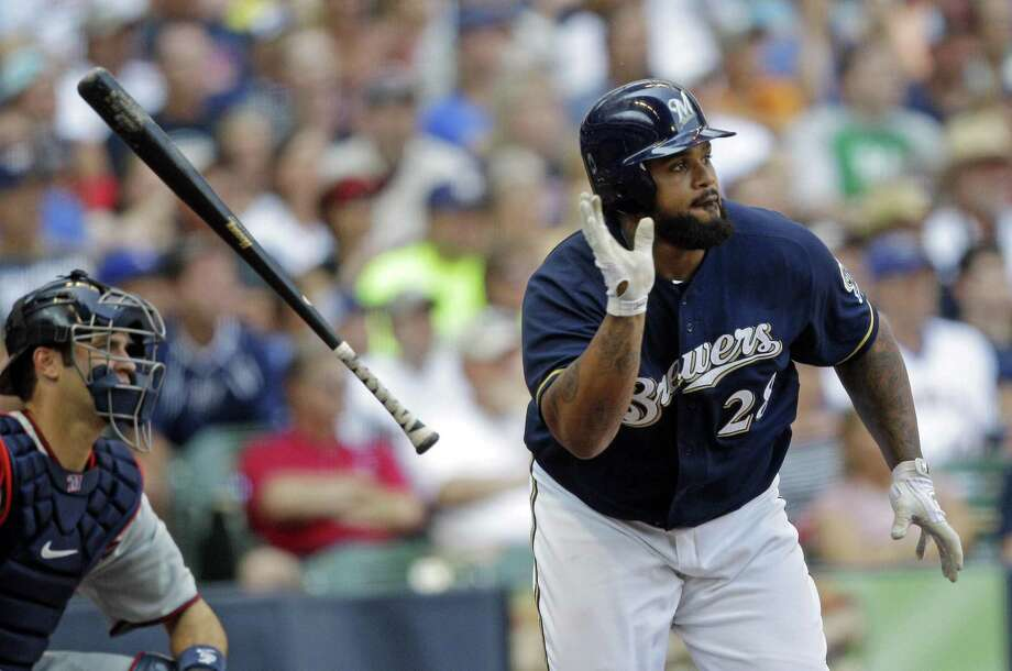Milwaukee Brewers' Prince Fielder, right, tosses his bat as he runs to first after hitting an RBI-single during the seventh inning of an interleague baseball game against the Minnesota Twins, Sunday, June 26, 2011, in Milwaukee. (AP Photo/Morry Gash) Photo: ASSOCIATED PRESS / AP2011
