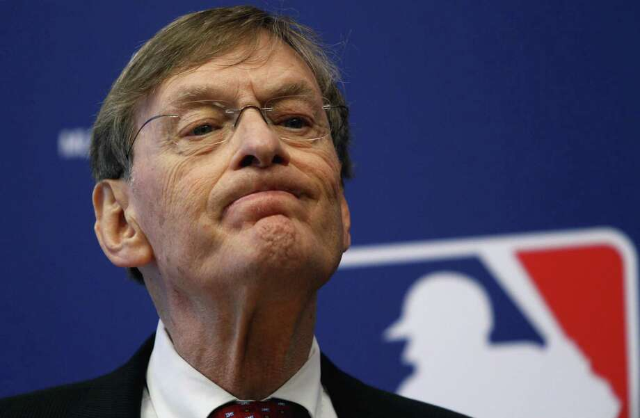 Baseball Commissioner Bud Selig listens to a question during a news conference on Thursday, May 12, 2011 in New York.  Selig gave Frank McCourt the face-to-face meeting the Los Angeles Dodgers owner wanted, but provided no timetable on approving a proposed $3 billion television deal with Fox that would keep the club from running out of cash at the end of the month. Selig and McCourt met Wednesday when owners began a two-day quarterly meeting at Major League Baseball's office.  (AP Photo/Bebeto Matthews) Photo: ASSOCIATED PRESS / AP2011