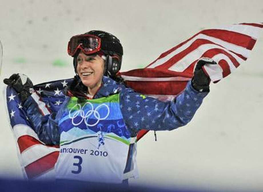 Hannah Kearney was the first American to claim gold at the  Vacouver Olympics, winning the women's moguls late Saturday night. Kearney's brother Denny, a junior on the Yale hockey team, watched his sister's winning run with his teammates on the bus trip back from a win over Cornell on Saturday night. (Associated Press) Photo: ASSOCIATED PRESS / AP2010