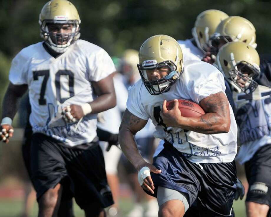 "Hartford Colonials fullback Asaph Schwapp runs the ball during practice Tuesday afternoon at Xavier High School in Middletown. To buy a glossy print of this photo and more, visit <a href=""http://www.middletownpress.com"">www.middletownpress.com</a>. (Catherine Avalone / TheMiddletownPress"