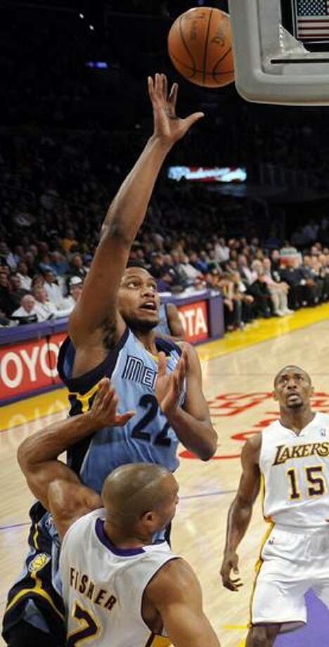Memphis Grizzlies forward Rudy Gay, top, puts up a shot as Los Angeles Lakers guard Derek Fisher, below, defends and forward Ron Artest looks on during the first half of their NBA basketball game, Sunday, Jan. 2, 2011, in Los Angeles. (AP Photo/Mark J. Terrill) Photo: ASSOCIATED PRESS / AP2011