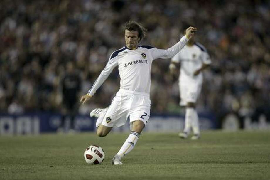 """FILE - In this Nov. 27, 2010 file photo, LA Galaxy's David Beckham is seen during a match against the Newcastle Jets at EnergyAustralia Stadium in Newcastle, Australia. Tottenham wants former England captain Beckham to play on loan for the Premier League club. """"It's whether (Los Angeles) Galaxy will let him go on loan,"""" Spurs manager Harry Redknapp was quoted as saying in British media reports on Saturday, Jan 1, 2011.  (AP Photo/Jeremy Piper, file) Photo: ASSOCIATED PRESS / AP2010"""