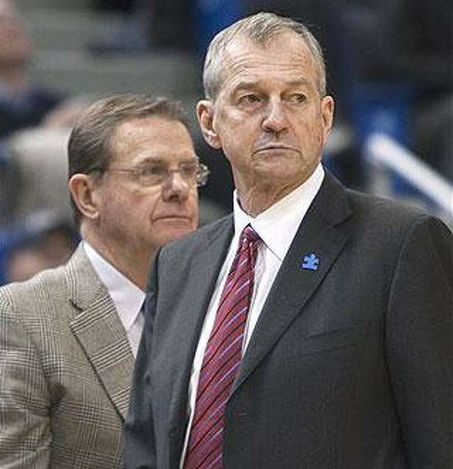 Coach Jim Calhoun was back on the bench for UConn on Saturday, but the Huskies' slide continued with a 60-48 loss to Cincinnati at the XL Center in Hartford. Behind him is assistant George Blaney who ran the team in Calhouns absence. (Associated Press)