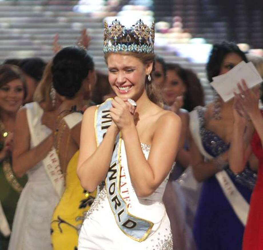 Alexandria Mills of the US, front center, reacts after being crowned as winner of the 2010 Miss World pageant contest at the Beauty Crown Cultural Center in Sanya, in southern China's island province Hainan, Saturday, Oct. 30, 2010. (AP Photo/Alexander F. Yuan) Photo: ASSOCIATED PRESS / AP