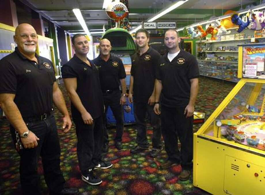 ** ADVANCE FOR SUNDAY OCT. 31 ** In this Oct. 25, 2010 photo, My Three Sons owner Jerry Petrini, left, Jay Petrini, second from left, general manager Matthew Bottone, third from left, Jerry Petrini Jr. second from right, and Matt Petrini pose in the store in Norwalk, Conn. (AP Photo/The Hour, Matthew Vinci) Photo: AP / The Hour