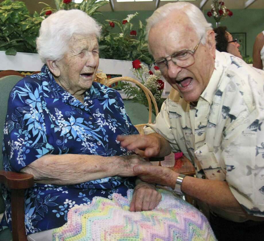 In this Sept. 3, 2010 photo, Onie Ponder, left, laughs with her nephew Dick Chazal during her 112th birthday party at Emeritus at Ocala East in Ocala, Fla. Onie Ponder died early Friday, Dec. 31, 2010. According to the Gerontology Research Group, Ponder had been the oldest person in Florida and one of the 25 oldest people in the world. (AP Photo/Ocala Star-Banner, Bruce Ackerman) Photo: AP / Ocala Star-Banner