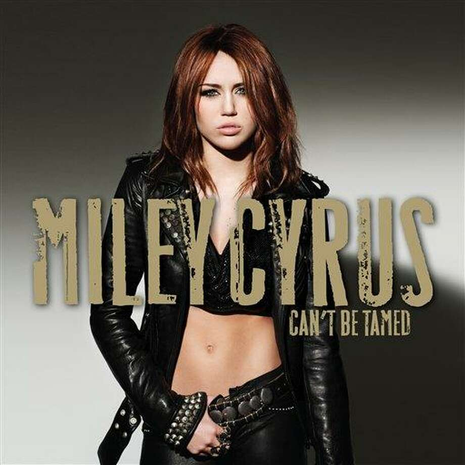 "In this CD cover image released by Hollywood Records, Miley Cyrus' latest ""Can't Be Tamed,"" is shown. (AP Photo/Hollywood Records) Photo: AP / Hollywood Records"
