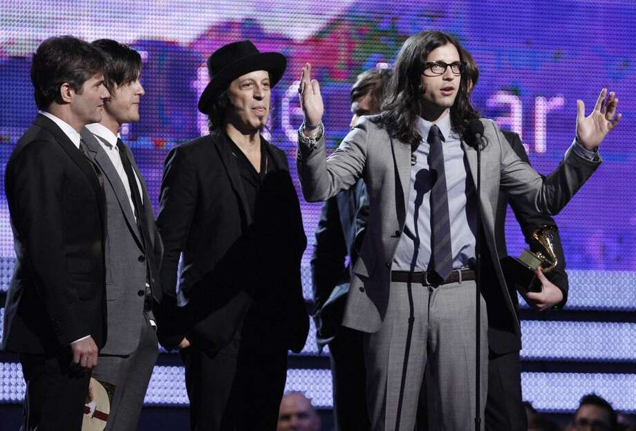 "In this Sunday, Jan. 31, 2010, file photo, the Kings of Leon accept the award for record of the year for ""Use Somebody"" at the Grammy Awards in Los Angeles. Bonnaroo organizers announced Tuesday, a lineup that features the likes of Kings of Leon and the Dave Matthews Band. (AP) Photo: AP / AP2010"