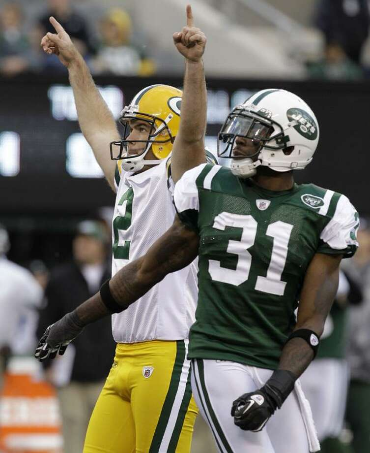 Green Bay Packers' Mason Crosby (2) gestures after kicking the third field goal of the game, as New York Jets cornerback Antonio Cromartie (31) watches during the fourth quarter of an NFL football game at New Meadowlands Stadium on Sunday in East Rutherford, N.J. The Packers won 9-0. (AP Photo/Kathy Willens) Photo: AP / AP