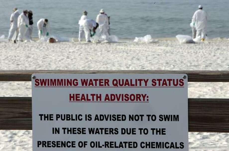 Cleanup crews work to remove oil form the Deepwater Horizon oil spill in Orange Beach, Ala. June 14. (AP) Photo: ASSOCIATED PRESS / FR159046 AP