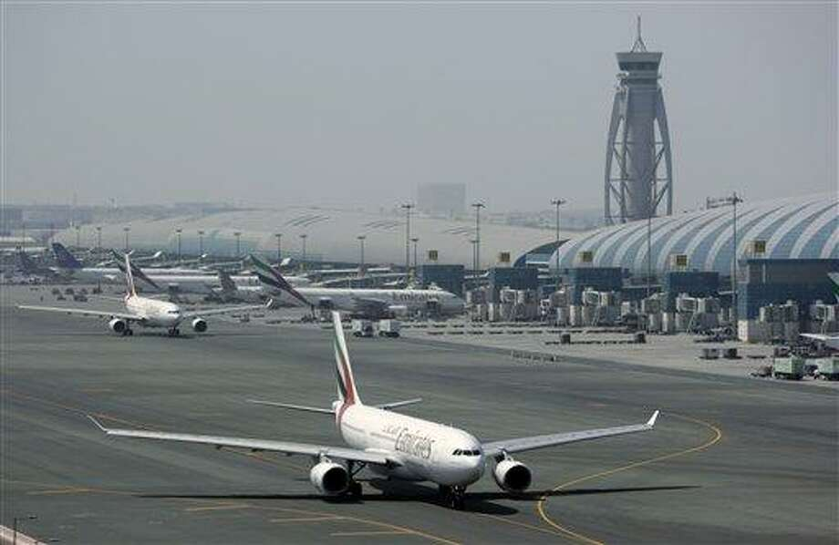 FILE - An Emirates airline passenger jet taxis on the tarmac at Dubai International airport in Dubai, United Arab Emirates, in this Tuesday April 20, 2010 file photo. A suspicious package originating in Yemen containing a toner cartridge with wires and powder was found during routine screening of air cargo in the United Kingdom, prompting authorities to scour three planes and a truck in the United States on Friday Oct 29 2010. A further package also sent from Yemen was intercepted in Dubai. U.S. officials said they were increasingly confident that the packages were part of a plot by Yemen's al-Qaida branch, the same group responsible for an attempted bombing of a U.S.-bound airliner last Christmas.  (AP Photo/Kamran Jebreili) Photo: AP / AP