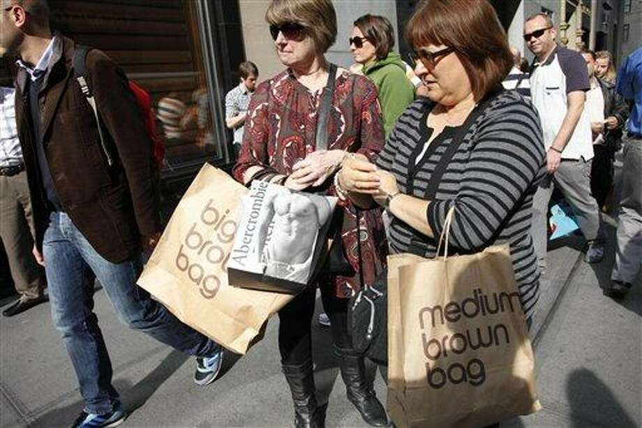 In this photo of Oct. 25, 2010, women carry their shopping bags on Fifth Ave. in New York. The economy grew at a slightly faster pace over the summer as Americans spent a little more freely. (AP Photo/Mark Lennihan) Photo: AP / AP