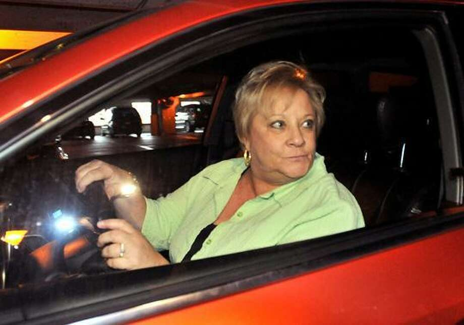 102910MS-A Juror who was dismissed from the Hayes murder trial, leaves the next door parking gaage.    Melanie Stengel/Register