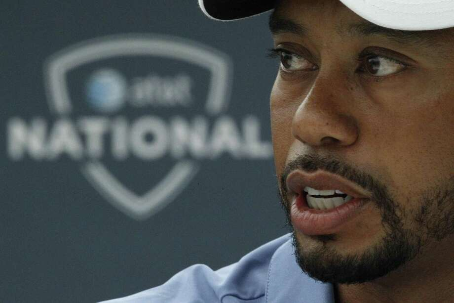 Tiger Woods makes remarks during a news conference at the AT&T National golf tournament at the Aronimink Golf Club Tuesday, June 28, 2011, in Newtown Square, Pa. Woods says he's done playing with pain. Woods says he is making progress in his recovery from injuries to his left leg, although he has no idea when he will return to golf. He says he has played with injuries too much in his career, and now is the time to be smarter about his health. (AP Photo/Matt Rourke) Photo: ASSOCIATED PRESS / AP2011