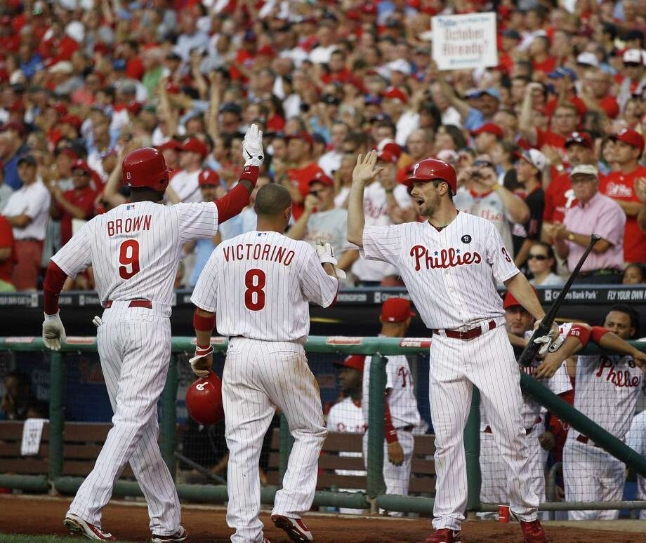 Philadelphia Phillies' Domonic Brown, from left, Shane Victorino and Cliff Lee celebrate after Brown's two-run home run in the second inning of an interleague baseball game against the Boston Red Sox, Tuesday, June 28, 2011, in Philadelphia. (AP Photo/Matt Slocum) Photo: ASSOCIATED PRESS / AP2011