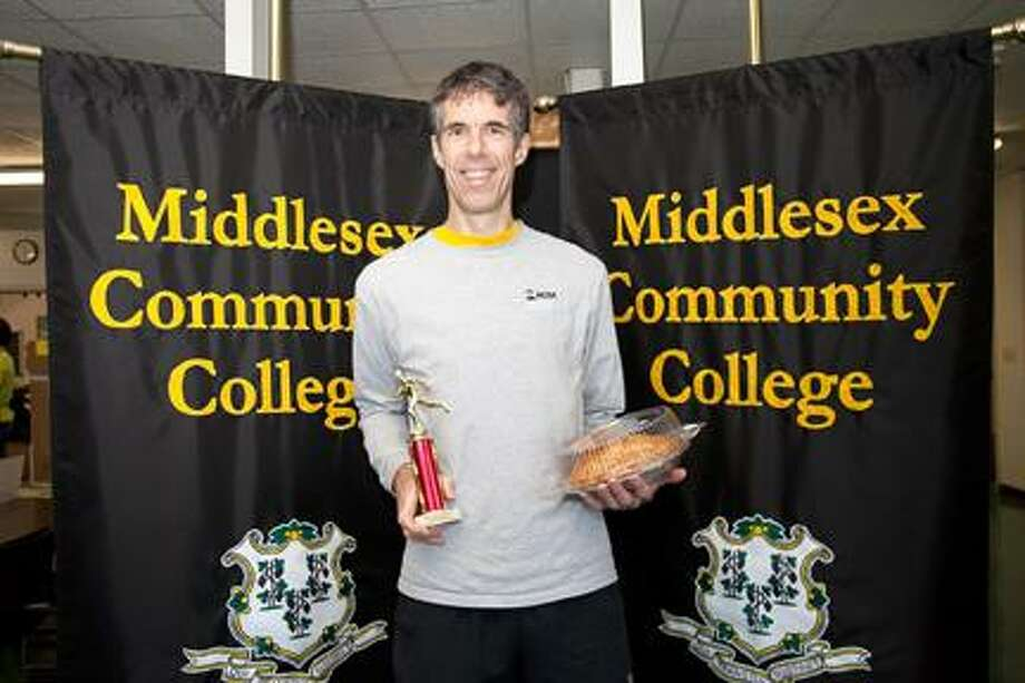 Race winner Scott Holmes shows his prizes.