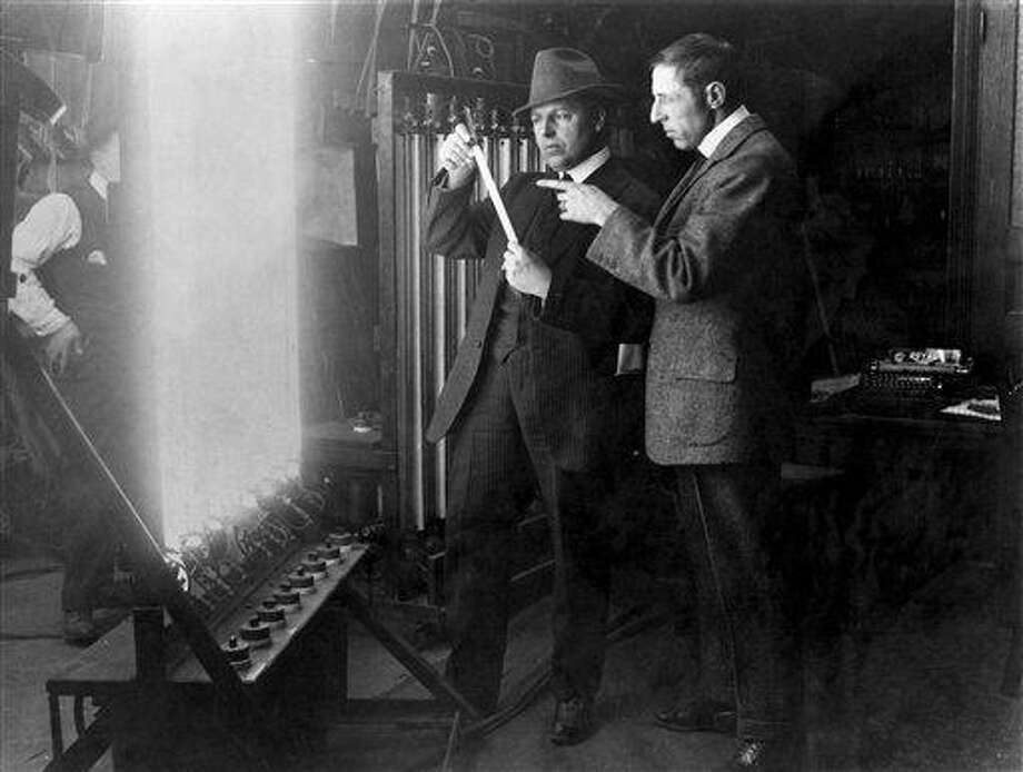 "In this 1913 publicity image released by TCM, G.W ""Billy"" Bitzer, center, and D.W Griffith discuss early lighting techniques in a scene from seven-part documentary series ""Moguls & Movie Stars: A History of Hollywood"" beginning Monday, Nov. 1, 2010 on the Turner Classic Movie channel. (AP Photo/TCM) ** FOR ONE-TIME EDITORIAL USE ONLY WITH JAKE COYLE'S STORY: TV-MOGULS AND MOVIE STARS.  NO SALES. ** Photo: AP / TCM"