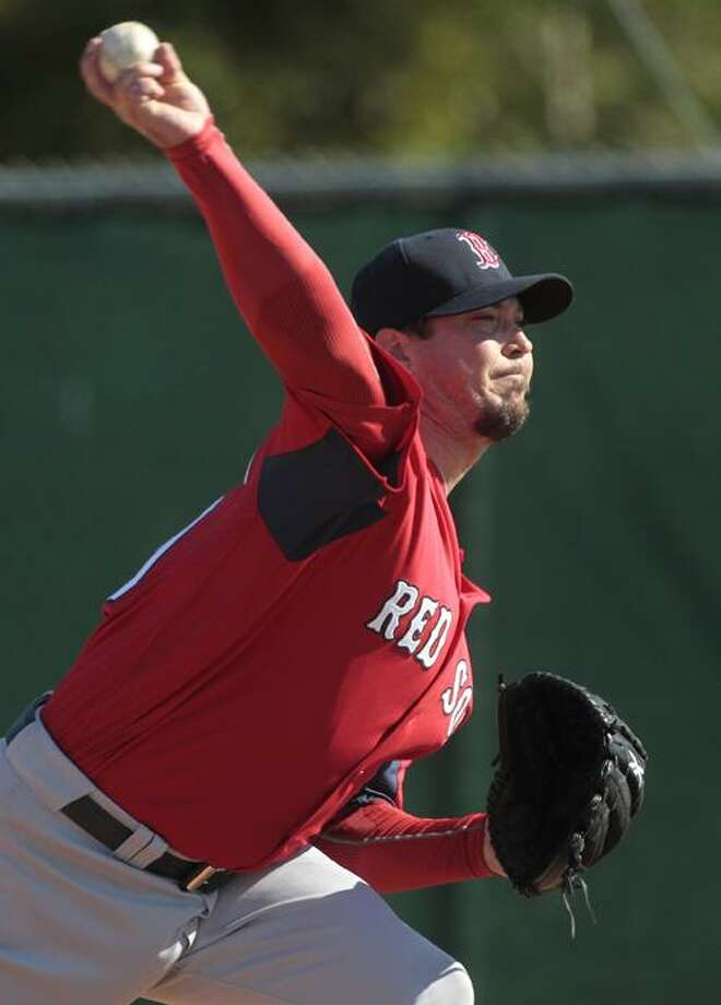 at the Boston Red Sox player development complex in Fort Myers, Fla., Tuesday, Feb. 15, 2011. It was the first official workout for pitchers and catchers.  (AP Photo/Dave Martin)