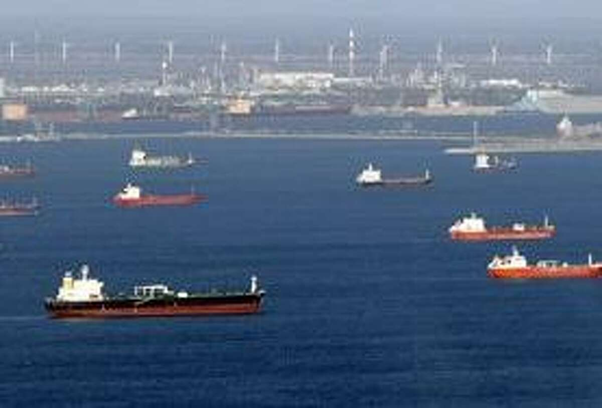 Aerial view of oil tankers and other vessels waiting off the coasts of Marseille, southern France, where oil terminals are blocked by striking workers, Tuesday, Oct. 26, 2010. Nationwide protests and strikes over raising the retirement age from 60 to 62 have disrupted French life and the country's economy for weeks, canceling trains, causing school closures and shutting down one gas station in four. (AP Photo/Claude Paris)