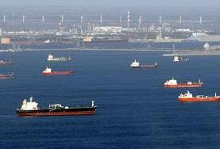 Aerial view of oil tankers and other vessels waiting off the coasts of Marseille, southern France, where oil terminals are blocked by striking workers, Tuesday, Oct. 26, 2010. Nationwide protests and strikes over raising the retirement age from 60 to 62 have disrupted French life and the country's economy for weeks, canceling trains, causing school closures and shutting down one gas station in four. (AP Photo/Claude Paris) Photo: AP / AP