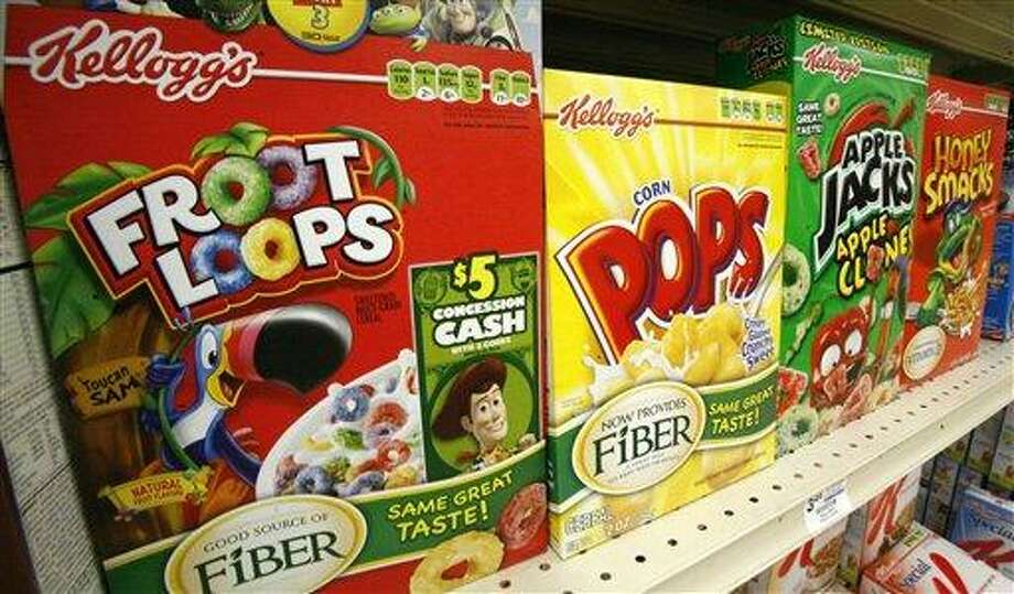 "Boxes of Kellogg's Froot Loops, Corn Pops, Apple Jacks, and Honey Smacks sit on the shelf of a Mt. Lebanon, Pa., grocery store  Friday, June 25, 2010. Kellogg Co. is voluntarily recalling about 28 million boxes of Apple Jacks, Corn Pops, Froot Loops and Honey Smacks cereals because a ""waxy"" smell and flavor coming from the package liners could make people sick, the company said Friday.(AP Photo/Gene J. Puskar) Photo: ASSOCIATED PRESS / AP"