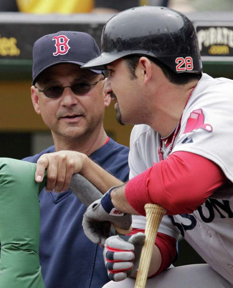 Boston Red Sox manager Terry Francona, left, talks with Adrian Gonzalez as he waits to hit during an interleague baseball game in Pittsburgh, Sunday, June 26, 2011. The Red Sox won 4-2.  (AP Photo/Gene J. Puskar) Photo: ASSOCIATED PRESS / AP2011
