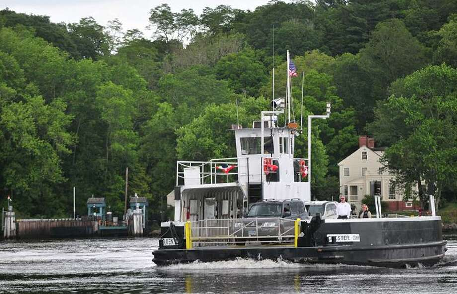 "The Middletown Press  6.27.11  First Mate, Diane Darcy adjusts the ramp in Chester to allow cars to exit the Chester-Hadlyme Ferry.  The two hundred year old is  the second oldest ferry in continuous use in Connecticut, owned and operated by the State Department of Transportation since 1917 to take cars, bicycles and passengers across the Connecticut River from April through November. The ferry operates from 7 am to 6:45 pm on weekdays, 10:30 am to 5 pm on Saturday and Sunday. To buy a print of this photo and more, visit <a href=""http://www.middletownpress.com"">www.middletownpress.com</a> / TheMiddletownPress"
