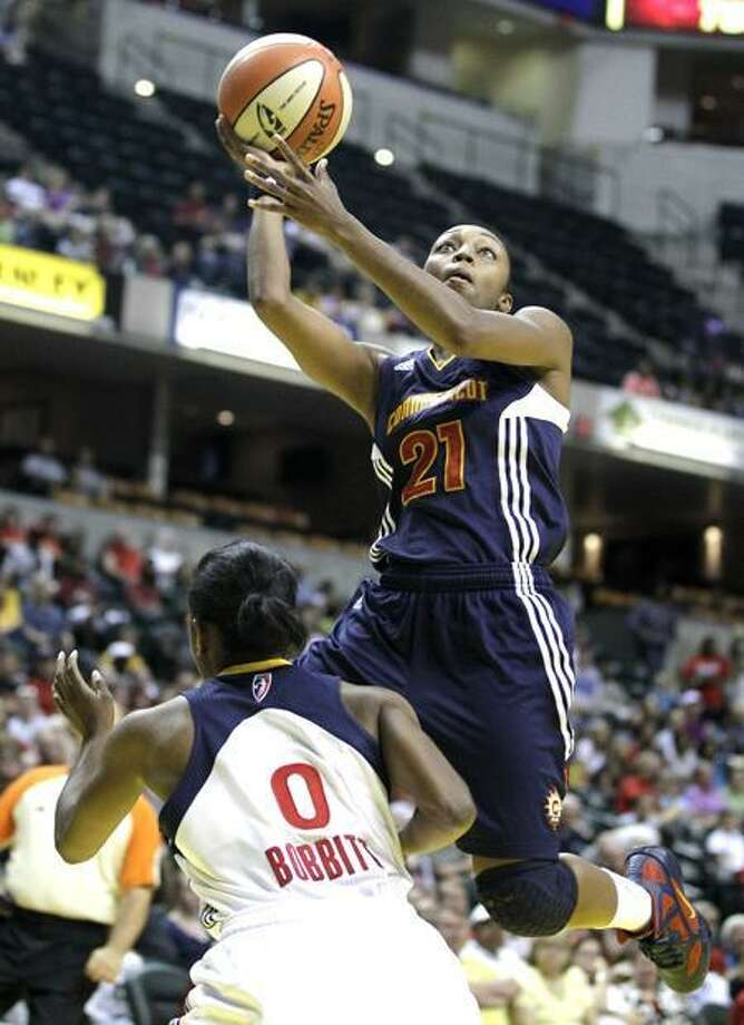Connecticut Sun's Renee Montgomery puts up a shot against Indiana Fever's Shannon Bobbitt during the first half of a WNBA basketball game in Indianapolis, Saturday, June 25, 2011. (AP Photo/Darron Cummings) Photo: AP / AP2011