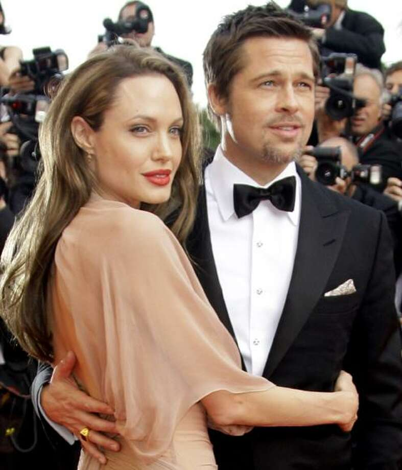 "In this May 20, 2009 file photo, Brad Pitt, right, and Angelina Jolie arrive on the red carpet for the film ""Inglourious Basterds,"" during the 62nd International film festival in Cannes, southern France. (AP) Photo: AP / AP2009"